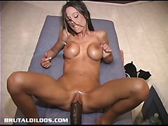 Busty babe playing with three brutal dildos