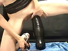 Woman with huge pump up dildo