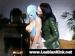 Lesbian in rubber mask fuck a mistress's dildo