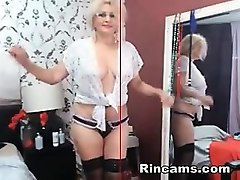 mature blonde glasses making an erotic show