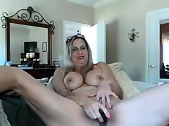 sexy mature blonde toying her wet pussy