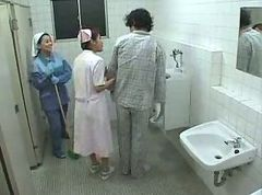 Asian Nurse And Cleaning Lady Help A Patient Jerk Off